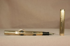 You can see on this gold-fill Conklin circa 1900 the crescent that would keep the pen from rolling off Twain's desk.