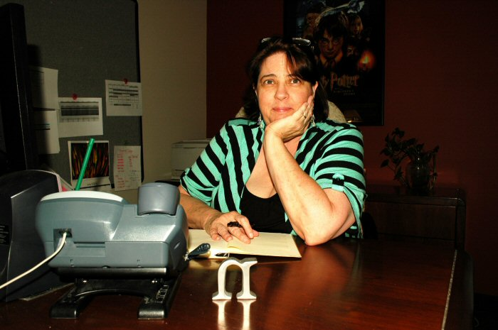 Nan Sampson, author of Restless Natives, ponder's her next story idea while holding her Waterman Phileas fountain pen.