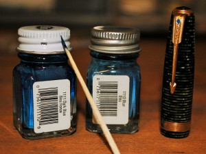 Use Testor's paints to fill in the blue diamond of your Parker Vacumatic clips. Some clips have old paint that tells how dark you should repaint it. Testor's 1111 Dark Blue paint is good for darker blue diamonds and 1110 is good for lighter blue diamonds. I used the 1110 Blue on the Vac Major you see in this photo. Also shown is a toothpick I use for the painting process.